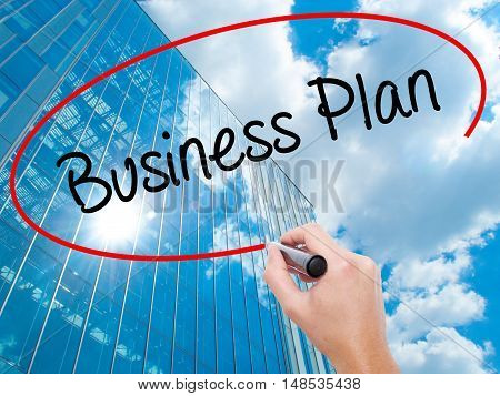 Man Hand Writing  Business Plan With Black Marker On Visual Screen