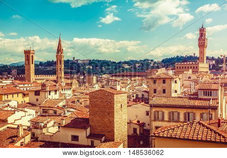 Florence Italy old town with houses tegular roofs and high tower on background blue sky vintage stylized