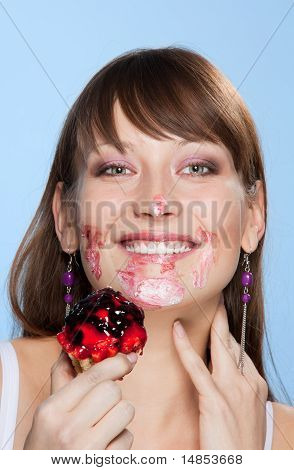 Happy Girl With Her Face Smear In Cake
