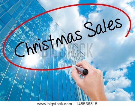 Man Hand Writing Christmas Sales With Black Marker On Visual Screen