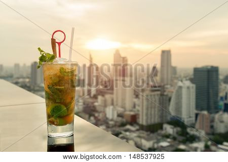Mojito cocktail on table in rooftop bar with Bangkok city view point in Bangkok Thailand. Beautiful rooftop bar in Bangkok.