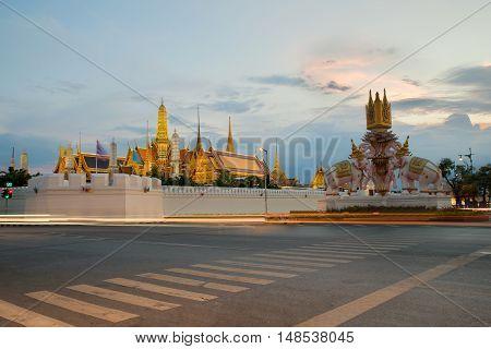 Grand palace and Wat phra keaw at sunset in Bangkok Thailand.