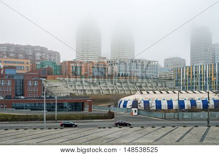 View of the city during heavy fog at warm winter evening