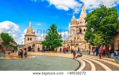 Budapest Fishermans Bastion square famous touristic landmark on background blue sky white clouds green trees