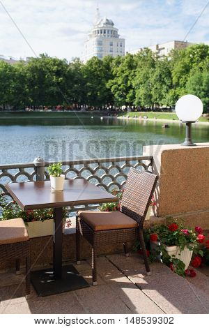 Romantic table in a summer cafe on the waterfront Patriarch ponds
