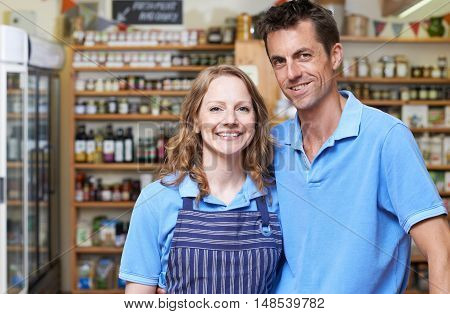 Portrait Of Male And Female Owners Of Delicatessen Store