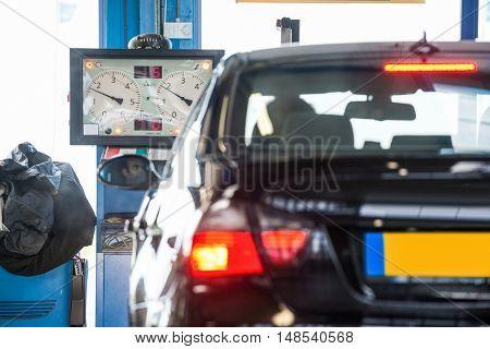Car in front of brake tester machine at garage