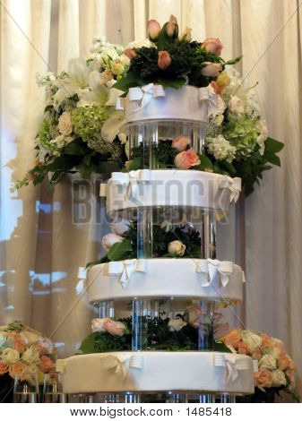 White Wedding Cake With Roses And Ribbons