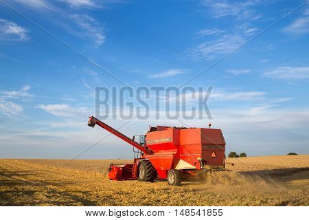 Ramlose, Denmark - August 24, 2016:  A combine harvester at work on a field