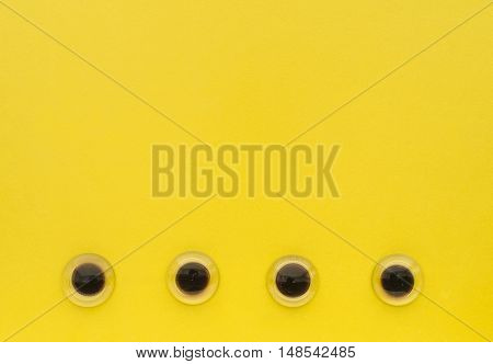 Yellow Color with eyes like glass pebbles background