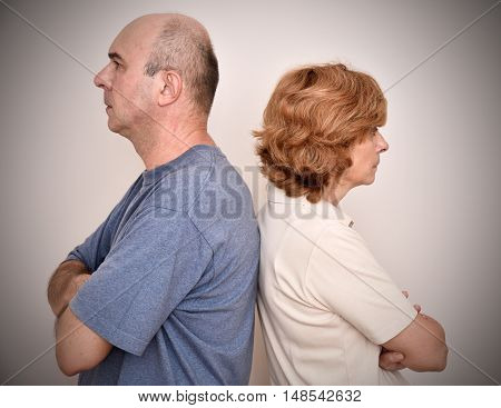 Angry woman and man turning their backs to each other