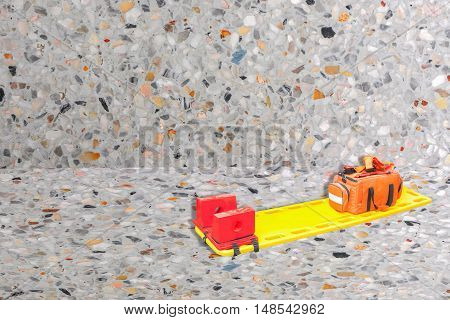 stretcher for emergency paramedic service medical equipment on Terrazzo Floor texture polished stone background