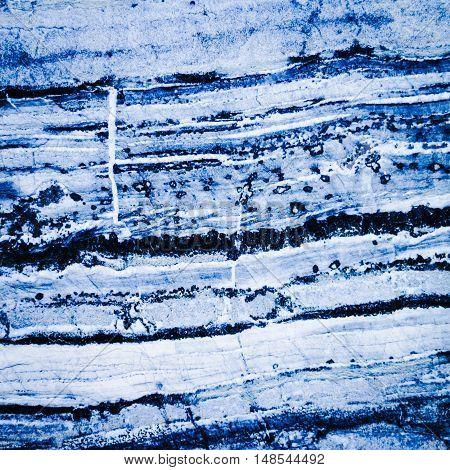 Square format full frame blue marble background.