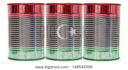 Three tin cans with the flag of Libya on them isolated on a white background.