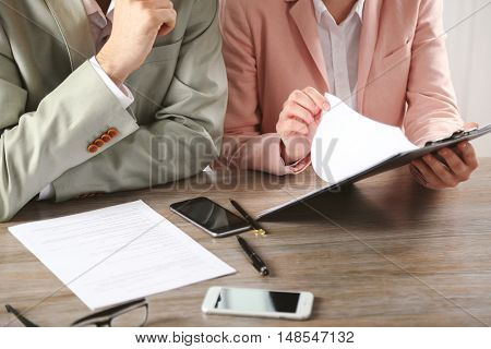 Human hands working with documents at the desk closeup