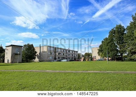 Block of flats in  East Europe. Residential block, playground, substation  in a rural area, Village.