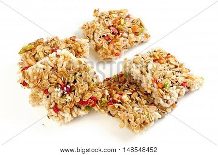 Crispy rice crust with honey topping on grains. many grains on white background.