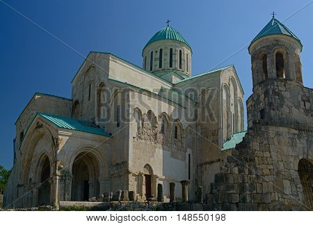 The Cathedral of the Dormition or the Kutaisi Cathedral more commonly known as Bagrati Cathedral against blue sky background.