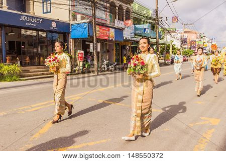 Phuket Thailand - Aug 26 2016 : Unidentified beautiful girls holding flower wreath as leader of parade of various schools in Phuket province on opening ceremony of yearly provincial sport.