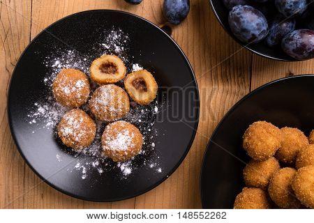 Plum Dumplings On Black Plate