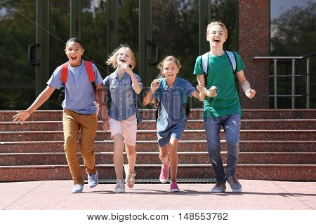 Cute kids running out of school