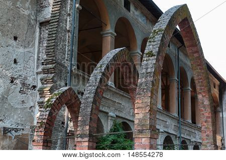Ruins Of An Antique Castle Building Entrance: Three Archs