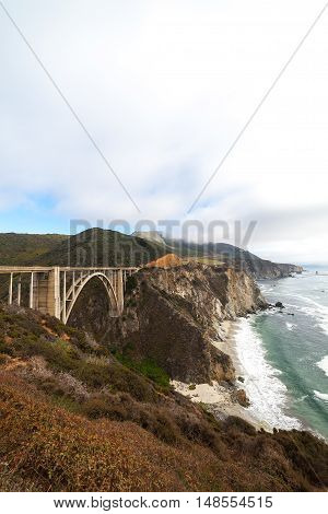 Landmark Bixby Creek Bridge in Big Sur, California. Cloudy weather.