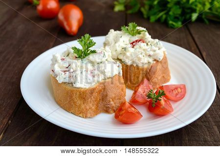 Sandwiches with pate cheese garlic slices of pepper dill. Organic health food. A healthy breakfast.