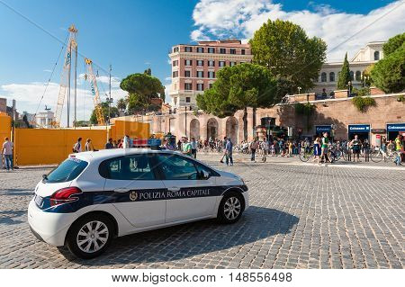 ROME, ITALY - September  12, 2016: Police car patrols nearby Rome subway (metro) station Colosseo near Historical monument Colosseum in Rome, Italy