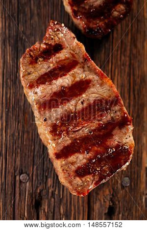 beef steak with vintage wooden board old  background