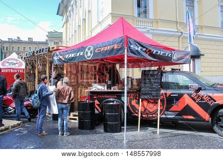 St. Petersburg, Russia - 12 August, Street cafe at motofestival,12 August, 2016. The annual International Festival of Motor Harley Davidson in St. Petersburg Ostrovsky Square.