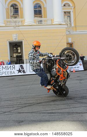 St. Petersburg, Russia - 12 August, Biker showing a motorcycle driving skills,12 August, 2016. The annual International Festival of Motor Harley Davidson in St. Petersburg Ostrovsky Square.