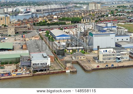 LONDON, ENGLAND - JULY 7, 2016: Aerial view of an industrialised district on the north bank of the Thames in the London Borough of Newham that is undergoing a major