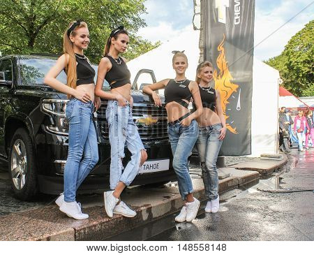 St. Petersburg, Russia - 12 August, Group of young girls in the SUV,12 August, 2016. The annual International Festival of Motor Harley Davidson in St. Petersburg Ostrovsky Square.