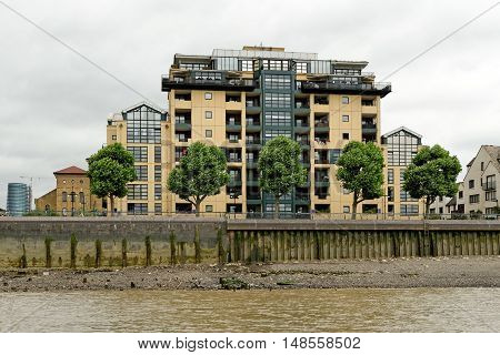 LONDON, ENGLAND - JULY 8, 2016: Burrells Wharf a riverside residential estate in the south-central Docklands. It is a listed building made up of eleven buildings