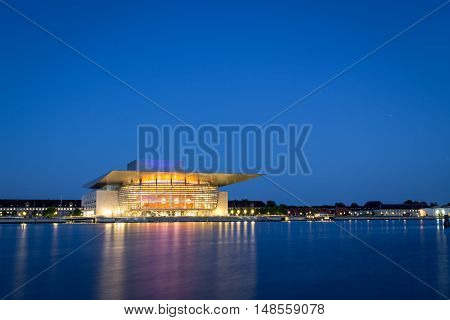 Copenhagen, Denmark - June 05, 2016: The illuminated Opera House designed by Henning Larsen architects by night