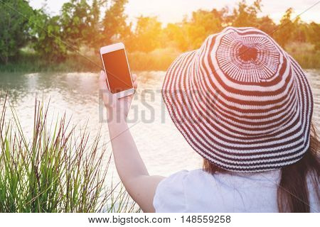 female hand using smartphone on relax time