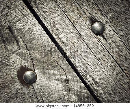 abstract background detail riveted on wooden boards