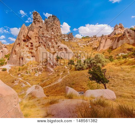 Panorama of a beautiful rocks with caves inside in Cappadocian area, Turkey