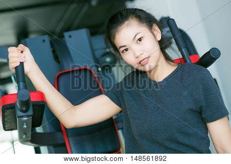 Asian Beautiful Fit Woman Exercising Building Muscles