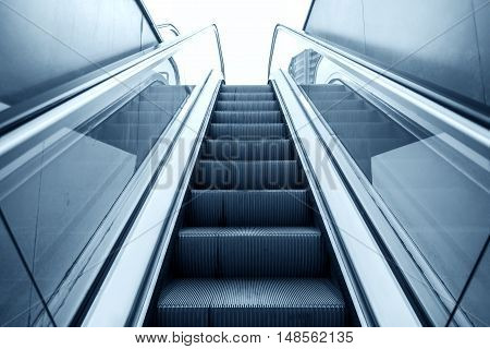 Lifting escalator. The descent into the subway, underpass, moving stairs