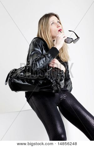 Sitting Woman Wearing Fashionable Black Clothes