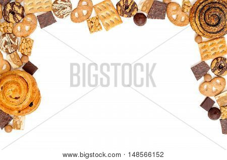 Background Of Cookies, Chocolate, Toffee, Truffles, Nougat And Bun. Isolated