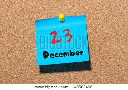 December 23rd. Day 23 of month Calendar on cork notice board. Winter time. Empty space for text.