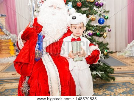 Happy little boy dressed as polar bear in New Year's holiday a children's holiday near Santa Claus