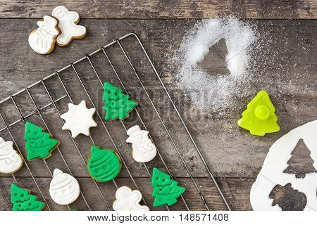 Delicious christmas cookies on wooden table background