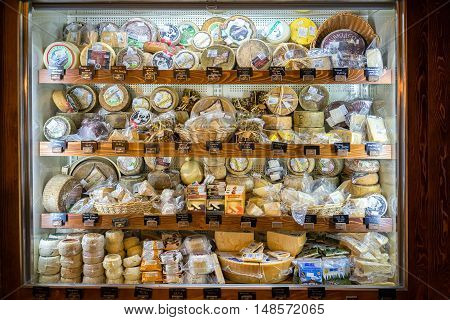 Kotor Montenegro - September 02 2015: cheese vitrina at their popular COGImar fish shop.