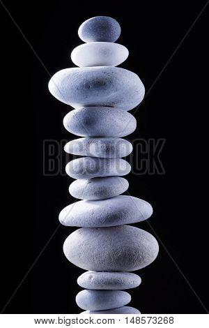 balancing Zen pebble tower