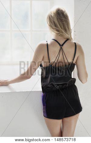 Beautiful blond woman in sleepwear posing in studio