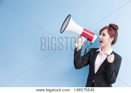 business woman take microphone happily and show fist with isolated on blue background